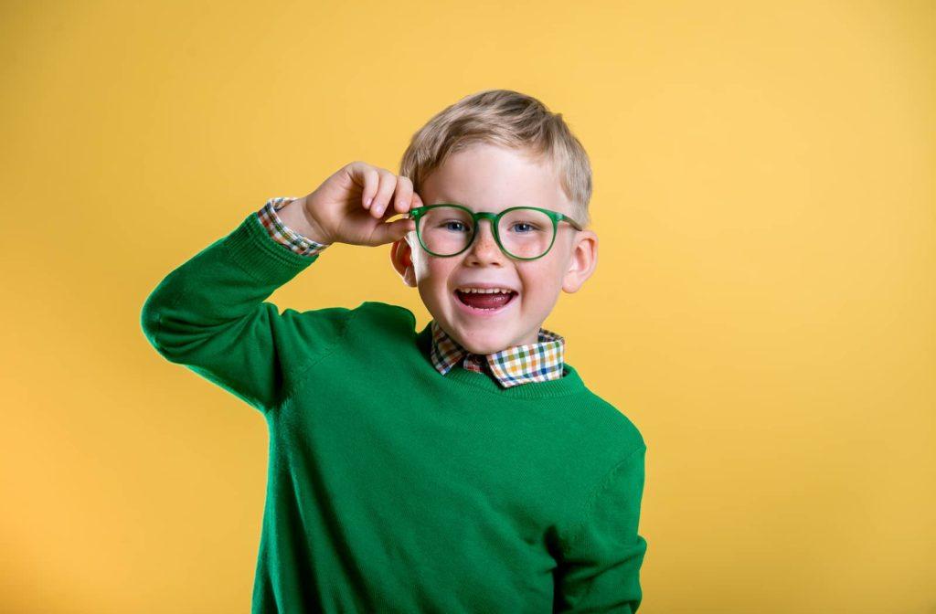 Child wearing glasses to help correct myopia