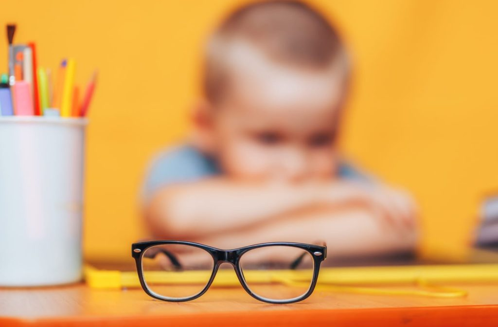 Blurry image of a child with glasses in focus